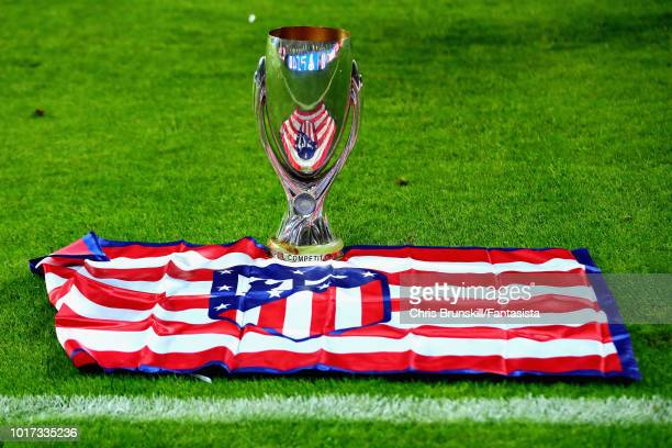 The UEFA Super Cup trophy is seen with an Atletico Madrid flag after they won the UEFA Super Cup between Real Madrid and Atletico Madrid at Lillekula...