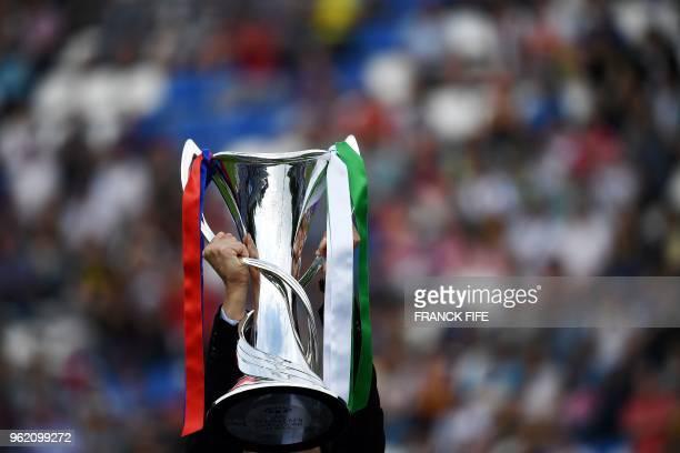 The UEFA Women's Champions League trophy is held up before the UEFA Women's Champions League final football match Vfl Wolfsburg vs Olympique Lyonnais...