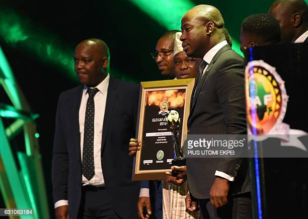 The Uganda national football team receives an award as African best national team during the African Footballer of the Year Awards in Abuja on...