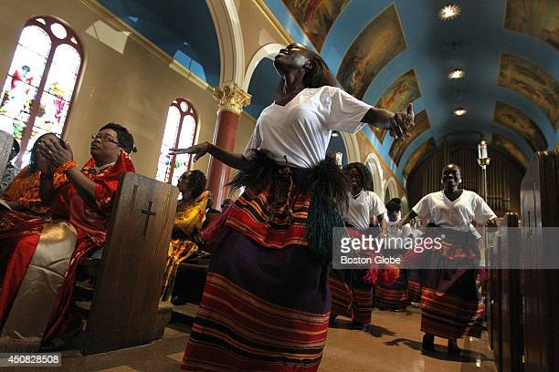 The Ugandan community gathers for Mass at St Mary Church for a Uganda Martyrs Day Celebration on June 15 2014 The Karolines move up the center isle...