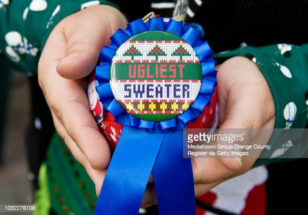 The Ugliest Sweater ornament award was won by Christine Lyng of Costa Mesa during the 2nd Annual Ugly Christmas Sweater Bike Ride in Huntington Beach...