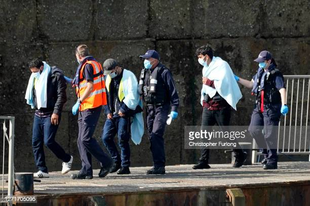The UK Border Force disembark migrants at Dover Marina after being intercepted in the English Channel on September 10 2020 in Dover England More than...