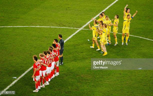 The Ukraine players celebrate their victory in a penalty shootout as the Swiss team look on at the end of the FIFA World Cup Germany 2006 Round of 16...