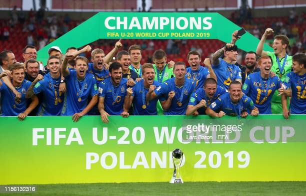 The Ukraine team celebrate with the FIFA U20 World Cup Trophy following their team's victory in the 2019 FIFA U20 World Cup Final between Ukraine and...