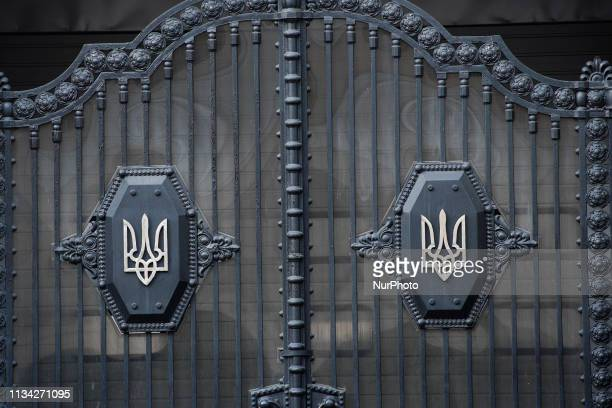 The Ukrainian coat of arms is seen on a gate in the Cabinet of Ministers building in central Ukraine on March 30, 2019.