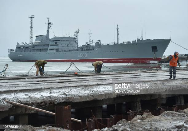 The Ukrainian command ship Donbass is seen moored as workers build new terminal at the Port of Mariupol on the Azov Sea eastern Ukraine on December 2...