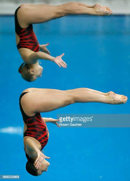 The Ukrainian diving team of Mariya Voloschchenko and Anna Pysmenska show nice form as they attempt a dive in the Women's 3M Synchronized Springboard...