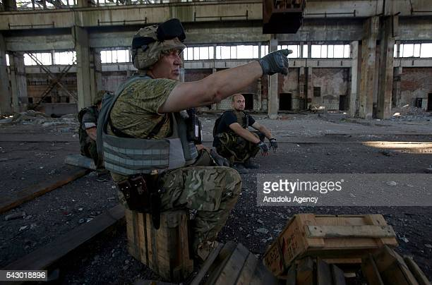 The Ukrainian soldiers make preparations during the fight with the proRussian separatists at the Avdiivka industrial zone in Avdiivka Donetsk region...