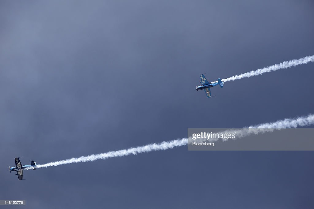 The U.K.'s Royal Air Force's (RAF) 'The Blades' display team performs in a flying display on the third day of the Farnborough International Air Show in Farnborough, U.K., on Wednesday, July 11, 2012. The Farnborough International Air Show runs from July 9-15. Photographer: Matthew Lloyd/Bloomberg via Getty Images