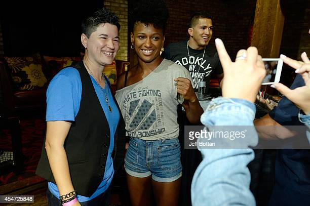 The Ultimate Fighter season 20 cast members Angela Hill poses with a fan at the UFC's The Ultimate Fighter 20 event inside the Shrine at Foxwoods...
