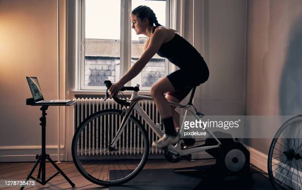 the ultimate way to fitness - peloton stock pictures, royalty-free photos & images