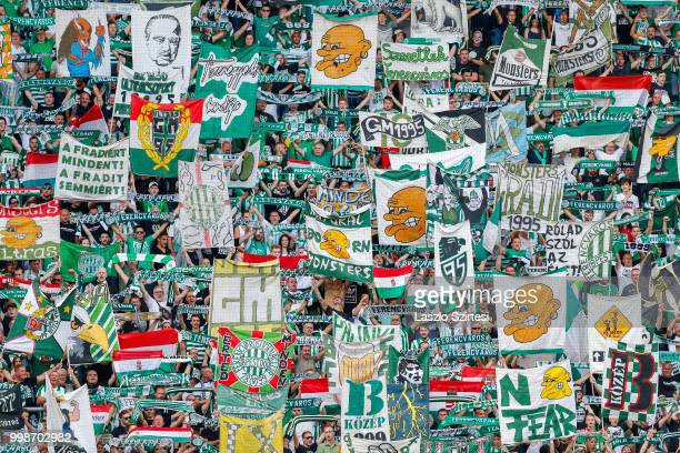 The ultra fans lift up flags and banners prior to the UEFA Europa League First Qualifying Round 1st Leg match between Ferencvarosi TC and Maccabi Tel...