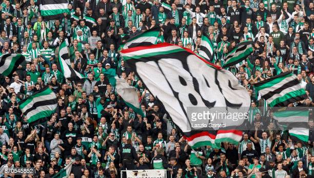 The ultras wave flags during the Hungarian OTP Bank Liga match between Ferencvarosi TC and DVSC at Groupama Arena on November 4 2017 in Budapest...