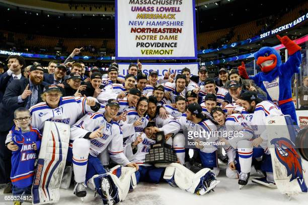 The UMass Lowell Riverhawks team poses with the Lamoriello Trophy after the Riverhawks win the Hockey East Conference Championship game against the...