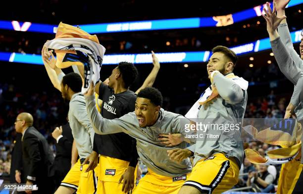 The UMBC Retrievers bench celebrates a growing second half lead against the Virginia Cavaliers during the first round of the 2018 NCAA Men's...