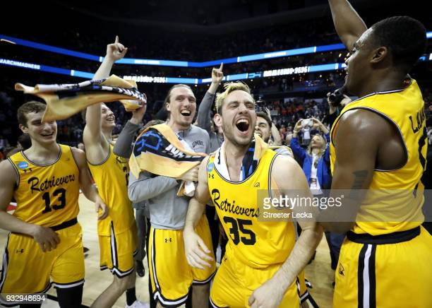 The UMBC Retrievers bench reacts to their 7454 victory over the Virginia Cavaliers during the first round of the 2018 NCAA Men's Basketball...