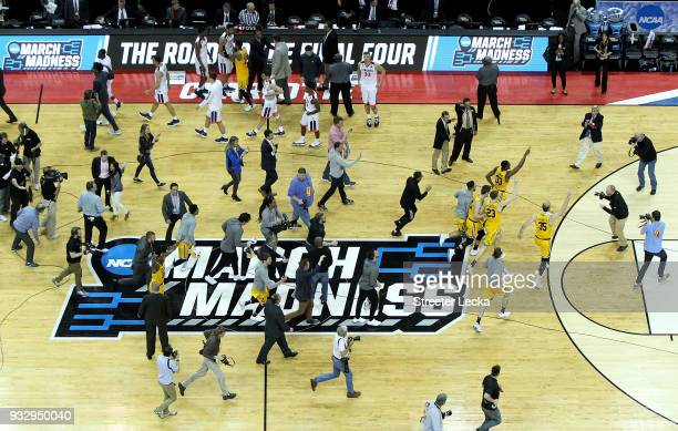 The UMBC Retrievers celebrate their 7454 victory over the Virginia Cavaliers during the first round of the 2018 NCAA Men's Basketball Tournament at...