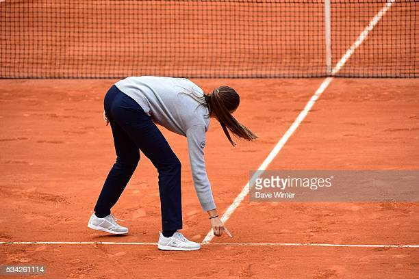 The umpire checks a line call during the Women's Singles second round on day four of the French Open 2016 at Roland Garros on May 25 2016 in Paris...