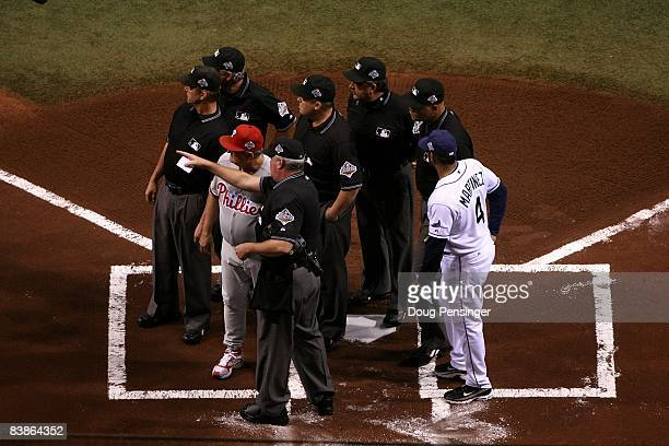 The Umpire crew go over the ground rukes prior to game one of the 2008 MLB World Series with Jimy Williams of the Philadelphia Phillies and bench...