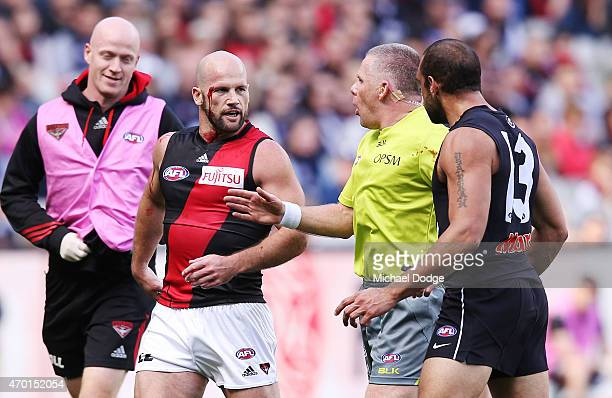 The umpire intervenes a confrontation between Paul Chapman of the Bombers and Chris Yarran of the Blues during the round three AFL match between the...