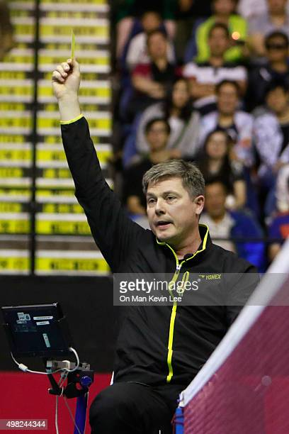 The umpire issues a yellow card to Carolina Marin of Spain during the match between Nozomi Okuhara of Japan and Carolina Marin of Spain at the final...