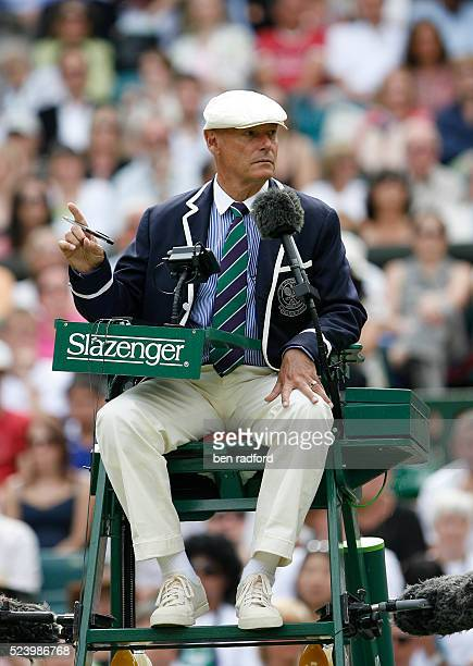 The Umpire makes a point during the First Round match between Rafael Nadal and Andreas Beck on Day 2 of the Wimbledon Championships at the All...