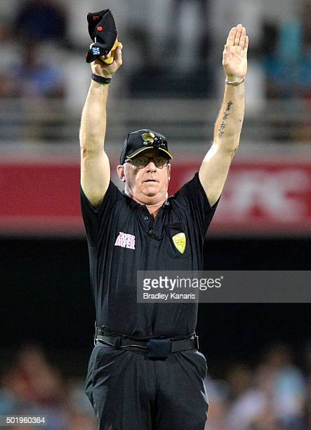 The umpire signals six runs after Nathan Reardon of the Heat hits the ball over the boundary during the Big Bash League match between the Brisbane...