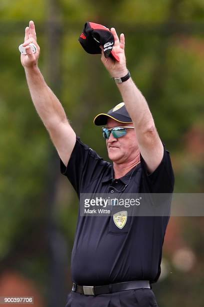 The umpire signals six runs during the Women's Big Bash League match between the Sydney Sixers and the Melbourne Renegades at Camberwell Sports...