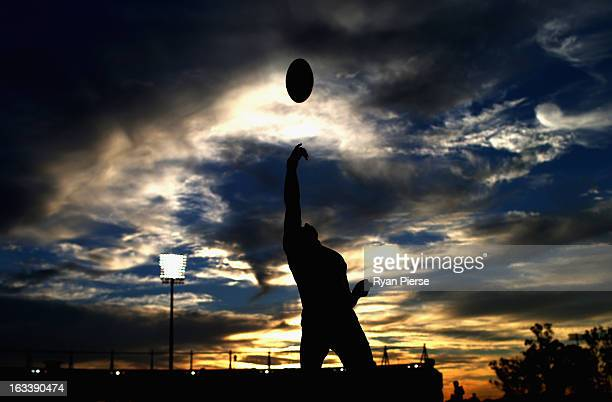 The umpire throws the ball into play during the round three NAB Cup AFL match between the Sydney Swans and the Gold Coast Suns at Blacktown...