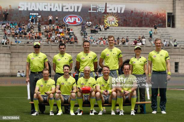 The umpires pose for a team photo during the 2017 AFL round 08 match between the Gold Coast Suns and Port Adelaide Power at Jiangwan Sports Stadium...