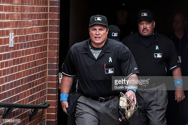 The umpiring crew including home plate umpire Marvin Hudson and third base umpire Wally Bell emerge from the clubhouse before a game between the...