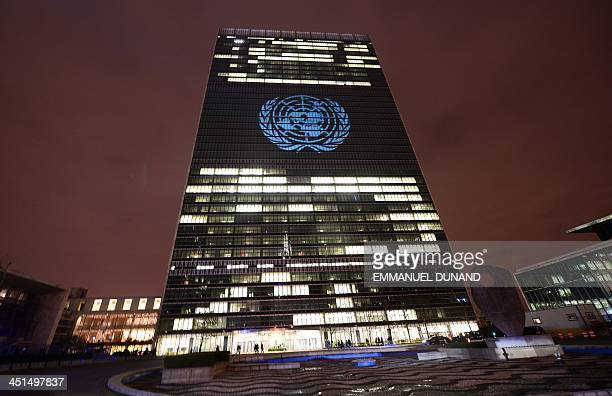 The UN logo is projected onto the United Nations headquarters before a video by French musician David Guetta is projected on it in support of 'The...