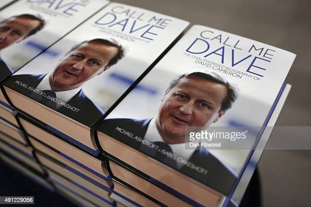 The unauthorised biography of David Cameron 'Call Me Dave' by Michael Ashcroft and Isabel Oakeshott is sold on a stand at the Conservative Party...