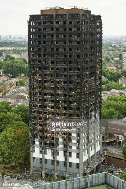 The unburned lower floors with untouched cladding still in place are pictured with the burnt out upper floors above at remains of the Grenfell Tower...