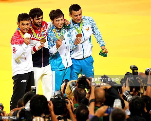 The under 60kg medallists , Naohisa Takato of Japan , Beslan Mudranov of Russia , Yeldos Smetov of Kazakhstan and Diyorbek Urozboev of Uzbekistan...