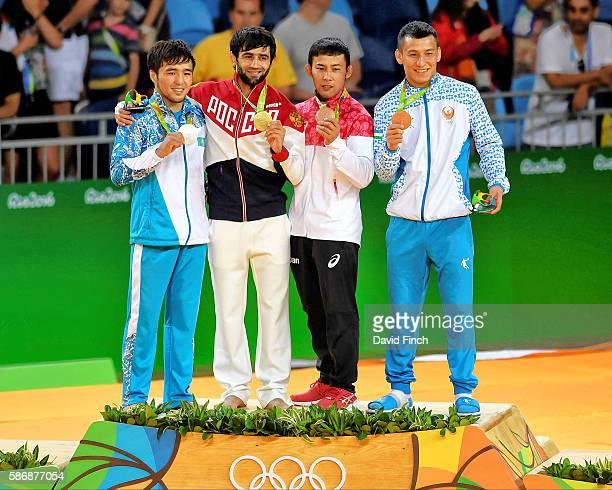 The under 60kg medallists , Yeldos Smetov of Kazakhstan , Beslan Mudranov of Russia , Naohisa Takato of Japan and Diyorbek Urozboev of Uzbekistan...