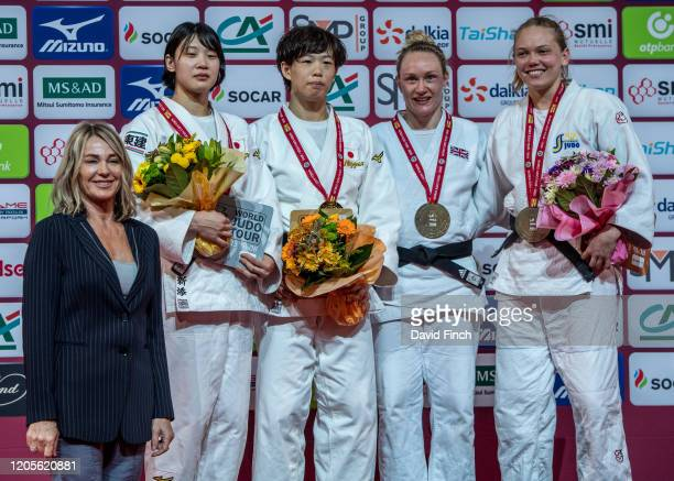 The under 70kg medals were presented by the Olympic gymnastics gold medallist Nadia Comaneci standing left The medallists were LR Silver Saki Niizoe...
