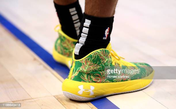 The Under Armour shoes of Patty Mills of the San Antonio Spurs at American Airlines Center on November 18, 2019 in Dallas, Texas. NOTE TO USER: User...