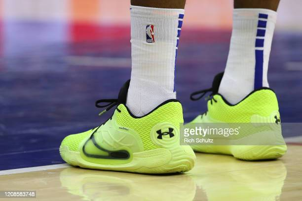 The Under Armour shoes worn by Joel Embiid of the Philadelphia 76ers during an NBA basketball game against the Atlanta Hawks at Wells Fargo Center on...