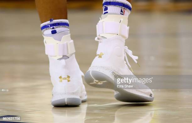 The Under Armour sneakers worn by Stephen Curry of the Golden State Warriors in the first half of their game against the Houston Rockets at ORACLE...