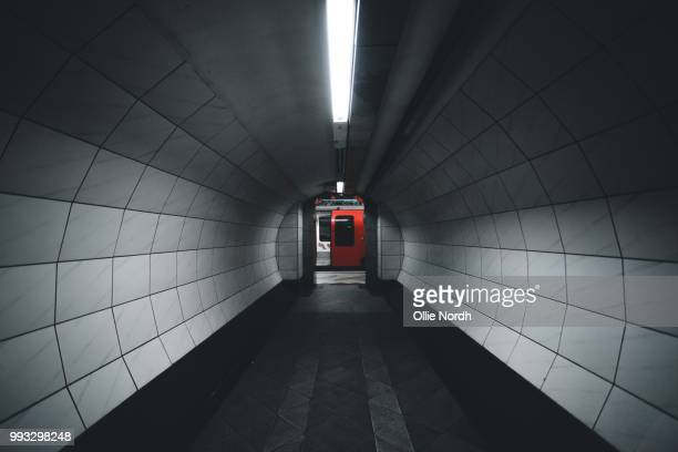 the underground in london, england. - tunnel stock pictures, royalty-free photos & images