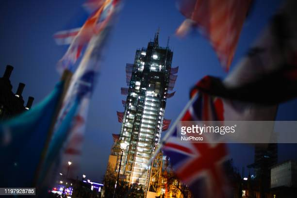 The under-renovation Elizabeth Tower, commonly known as Big Ben, stands shrouded in scaffolding as Union Jack flags wave amid Brexit celebrations in...