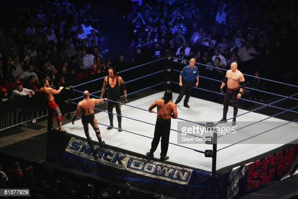 The Undertaker and ECW Champion Kane stand in the ring as they look towards Bam Neely, Chavo Guerrero, and The Great Khali during WWE Smackdown at...