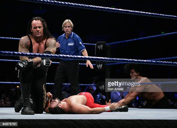 The Undertaker celebrates his victory during the WWE Smackdown at Acer Arena June 15 2008 in Sydney Australia