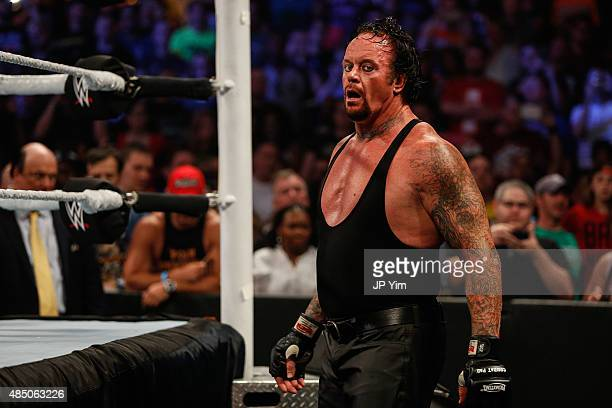 The Undertaker recovers during his fight against Brock Lesner at the WWE SummerSlam 2015 at Barclays Center of Brooklyn on August 23 2015 in New York...