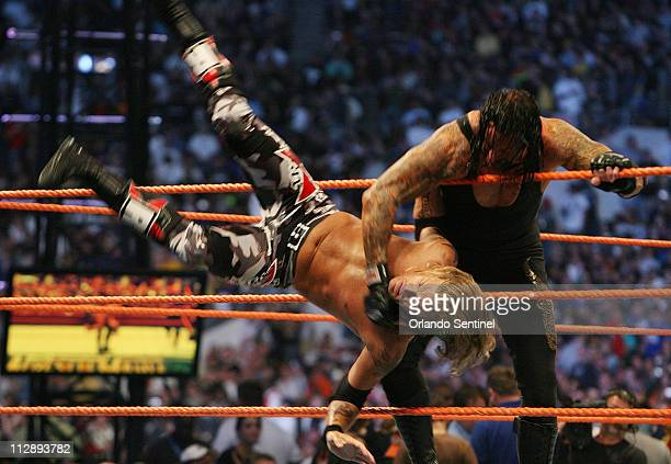The Undertaker throws Edge out of the ring during WrestleMania XXIV at the Citrus Bowl on Sunday March 30 in Orlando Florida