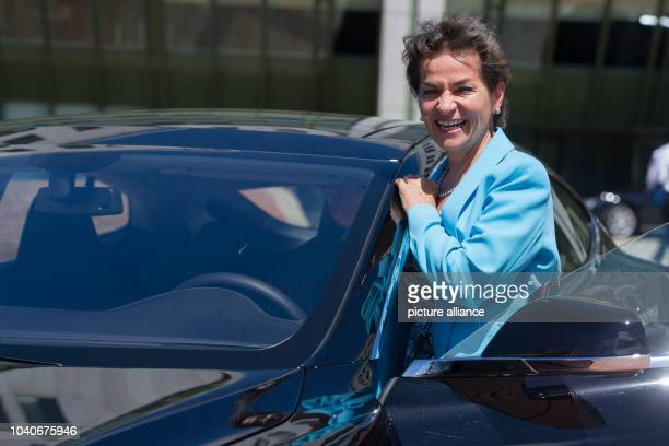 The UNFCCC executive secretary Christina Figueres stands in front of a Tesla model S which is the first limousine powered by electricity during the...
