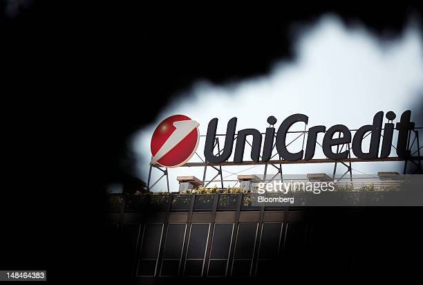 The UniCredit SpA logo sits on the roof of the company's headquarters in Rome, Italy, on Tuesday, July 17, 2012. UniCredit SpA and Intesa Sanpaolo...