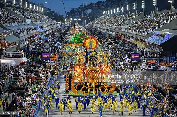 The Unidos da Tijuca samba school winner of the 2014 Rio Carnival performs during the Champions' parade of the carnival's victorious samba schools at...