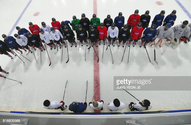 TOPSHOT The Unified Korea's women's ice hockey team head coach Sarah Ruth Murray speaks to her team during a training session at the Kwandong Hockey...